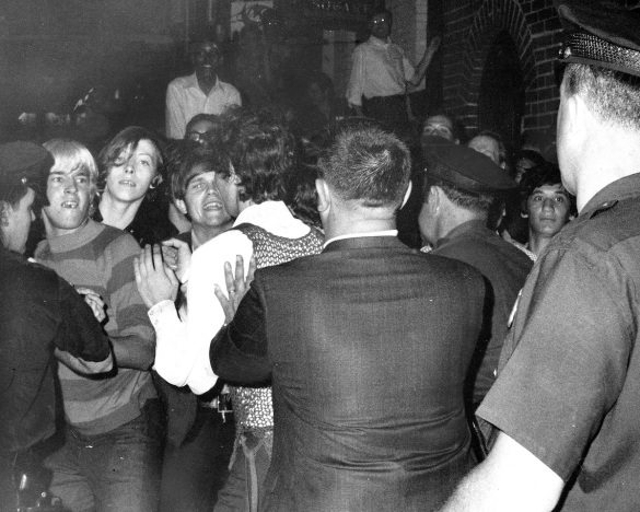 Stonewall Inn nightclub raid. Crowd attempts to impede polic